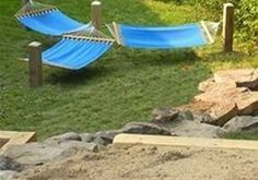 Put some stakes in the ground to make a lounging trio of hammocks.